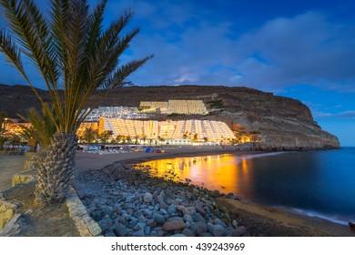 Atlantic beach of Gran Canaria island in Taurito at dusk, Spain