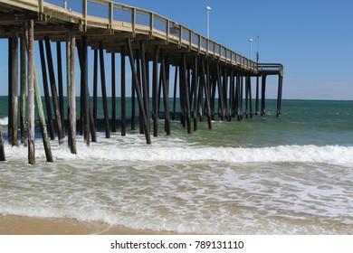 Atlantic beach pier with waves breaking
