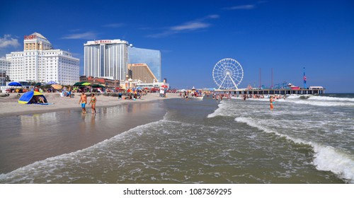 ATLANTIC CITY, NEW JERSEY - AUGUST 19, 2017: Beach and Steel Pier in Atlantic City. Established in the 1800s as a health resort, today the city is dotted with modern high-rise hotels.