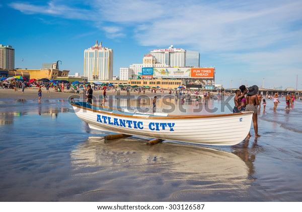 ATLANTIC CITY,  NEW JERSEY - August 3: The boardwalk and Casinos on August 3, 2015 in Atlantic City, New Jersey. Gambling was legalized in the city in 1976 and led to a resurgence.