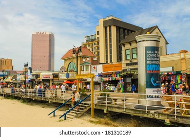 ATLANTIC CITY, NEW JERSEY - June 23, 2013 - Boardwalk with Bally's Hotel and Casino