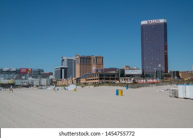 Atlantic City, New Jersey - May 24, 2019: View of Casino buildings as seen from the beach. Signs for Bally's, Caesar's and the Tropicana Hotels and Casinos are visible