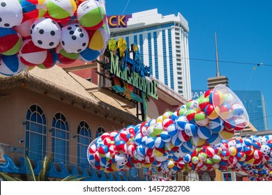 Atlantic City, New Jersey - May 24, 2019: The start of the summer shore beach season was celebrated in front of Jimmy Buffett's Margaritaville Restaurant. Beach ball balloons were dropped on crowd