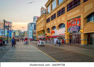 ATLANTIC CITY NEW JERSEY - SEPTEMBER 2: The boardwalk at sunset on September 2 2014 in Atlantic City New Jersey.