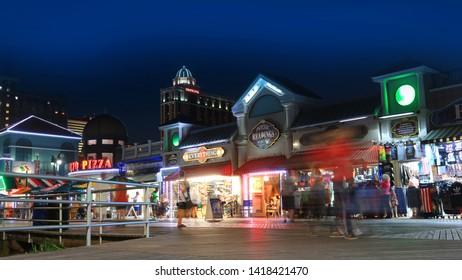 ATLANTIC CITY NEW JERSEY - Shops along the world famous board walkin night time on July 4, 2018 in Atlantic City New Jersey.