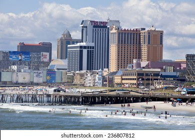 Atlantic City, New Jersey, USA - Aug 24, 2014: View of the beach, boardwalk and casinos along the coastline of Atlantic City, New Jersey during summer day in Atlantic City, New Jersey on Aug 24, 2014