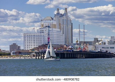 Atlantic City, New Jersey, USA - August 22, 2016: Ocean view of Atlantic City, New Jersey showing The Showboat, Taj Mahal and Resort Casino and Steal Amusement Pier with sailboat  on August 22, 2016