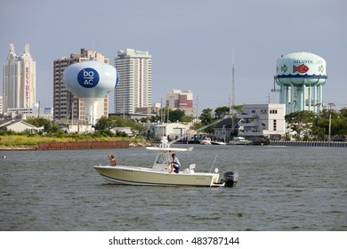 Atlantic City, New Jersey, USA - July 16, 2016: Boating in the back bay of the Historic Gardnerâ??s Basin area skyline showing the Resorts Hotel & Casino of Atlantic City, New Jersey July 16, 2016
