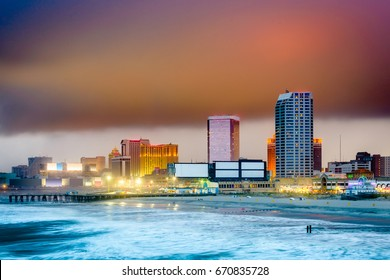 Atlantic City, New Jersey, USA beach and skyline with storm clouds.