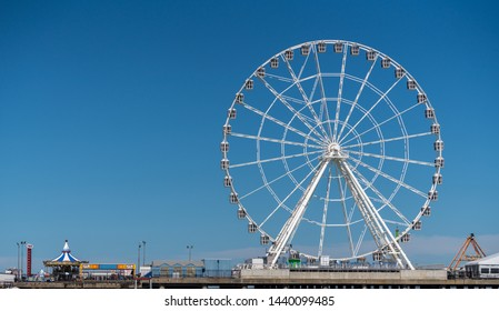Atlantic City, NJ - 11 June 2019: White ferris wheel on Steel Pier in Atlantic City on the New Jersey coast
