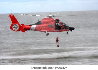 ATLANTIC CITY, NJ - AUGUST 24:  US Coast Guard HH-65A Dolphin helicopter drops rescue diver during rescue exercise August 24, 2010 in Atlantic City,  New Jersey
