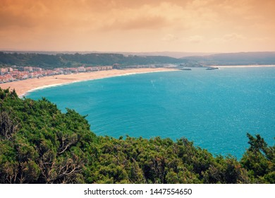 Atlantic ocean, beach in Nazare. View from mount of Nazare city in evening, Portugal, Europe