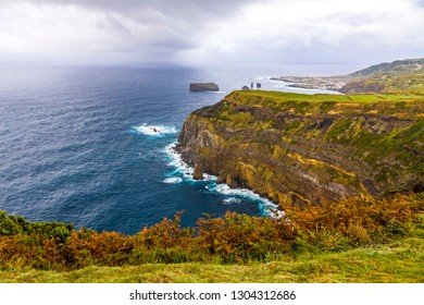 Atlantic Ocean coast of Sao Miguel Island, the largest island in the Portuguese archipelago of the Azores. Feteiras village on background