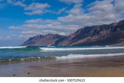 Atlantic ocean, coastline of Lanzarote island, Spain. Famara beach (Caleta de Famara)