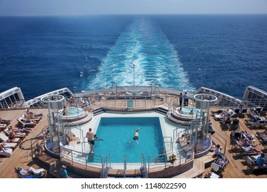 ATLANTIC OCEAN, INTERNATIONAL WATERS - JULY 18, 2017: with several pools on her stern decks, the Queen Mary 2 offers maximum comfort during transatlantic cruises.