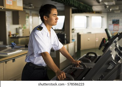 Atlantic Ocean - October 16, 2016: Young Chinese navigator is doing ocean passage by using electronic navigation devices. These procedures are crucial in order to maintain safety of life at sea