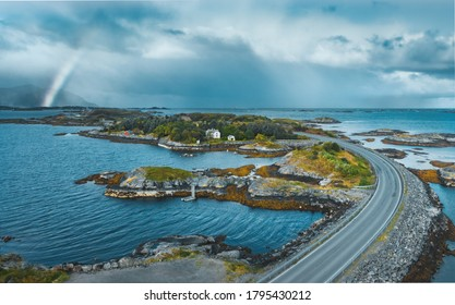 Atlantic ocean road landscape in Norway aerial view stormy weather nature clouds with rainbow drone scenery scandinavian trip travel beautiful destinations