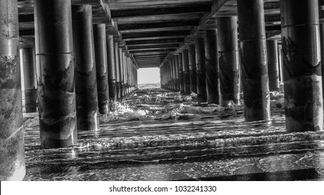 The Atlantic Ocean sends waves to crash against these pillars.
