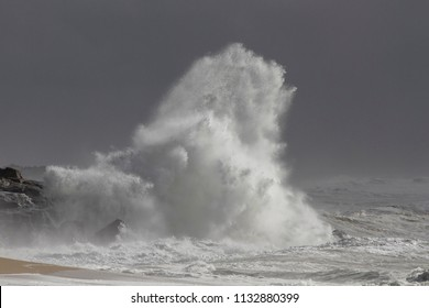 Atlantic Ocean storm. Northern portuguese coast during a heavy stormy with huge dancerous splashes but with a beautiful light.