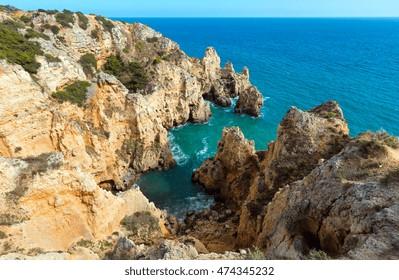 Atlantic ocean summer rocky coastline view (Ponta da Piedade, Lagos, Algarve, Portugal).