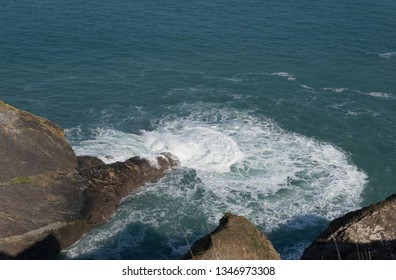 Atlantic Ocean and Waves by Mutton Cove on the South West Coast Path between Portreath and Hayle in Rural Cornwall, England, UK