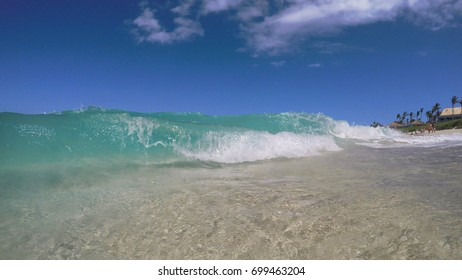 Atlantic Ocean waves during a beautiful day at the beach! Nassau, Bahamas.