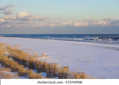 Atlantic ocean waves on the beach at Hamptons, Long Island, New York, Suffolk County in Winter, 2017