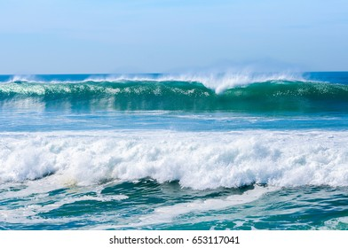 Atlantic Ocean waves on the coast of Portugal on a sunny day