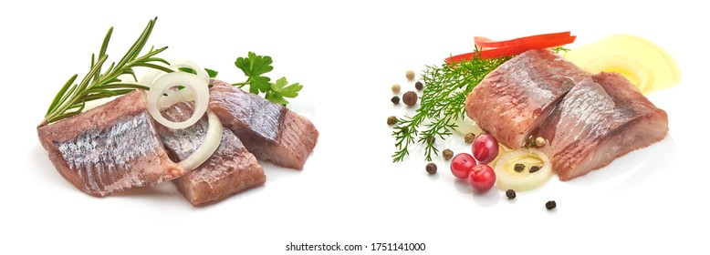 Atlantic salted herring fillet with onion ring and pepper, isolated on white background.