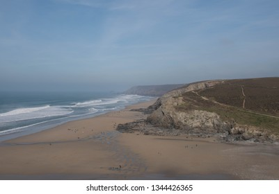 Atlantic Waves Breaking on the  Popular Sandy Surfing Beach at the Seaside Village of Porthtowan on the South West Coast Path between Perranporth and Portreath in Rural Cornwall, England, UK