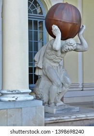 Atlas loaded.  Białystok, Poland May 03, 2019 Atlas sculpture carrying the globe at the Branicki Palace in Bialystok.