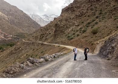 Atlas Mountains, Morocco, circa November 2016. Tourists on their way through a valley to Jabal Toubkal pick.