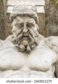 Atlas statue holding a portico. Stone sculptures of male torsos