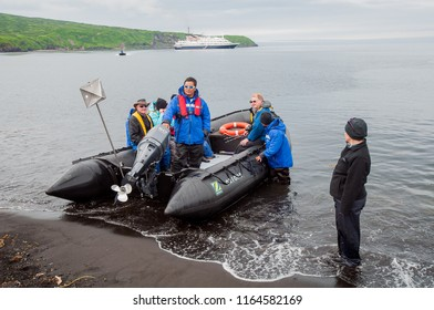 Atlasov I, Siberia/Russia - July 11 2011: A Zodiac inflatable loads up to shuttle passengers back to their anchored ship. Zodiacs allow access to wilderness areas with no infrastructure.