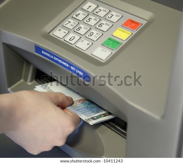 ATM Access - woman withdraw money at cashpoints