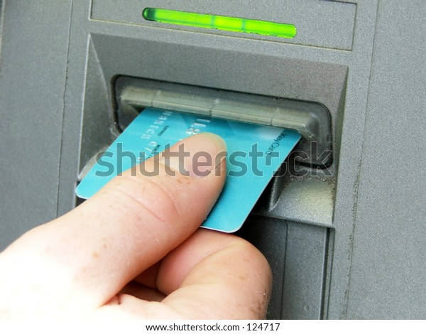 ATM hand putting card in