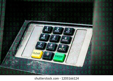ATM keypad at a bank machine with overlay of green numbers.