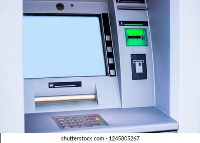 ATM machine blue background