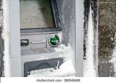 Atm machine covered with snow. Functional bank atm machine covered with ice and snow.