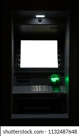 ATM machine at night. Blank white screen for text.