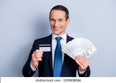 Atm people make wealth promo promotion person concept. Close up portrait of confident excited joyful with toothy smile millionaire demonstrating pack of money plastic card isolated on gray background
