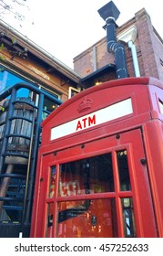 ATM in red telephone box