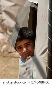 Atmeh Refugee Camp, Idlib, Syria. June 17th 2013. Internally displaced child Syrian refugeein the Atmeh refugee camp, Idlib province Syria
