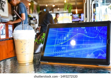 The atmosphere of drinking iced coffee with the tablet device in the morning.  In a local coffee shop in Lop Buri  Thailand - South East Asia