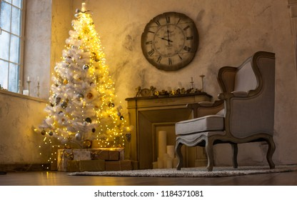The atmosphere of the holiday. New Year's interior. Wall clock with fireplace and Christmas tree