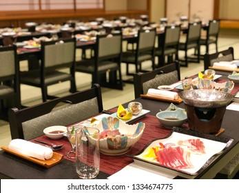 Atmosphere of Japanese kaiseki set for dinner party in ryokan.