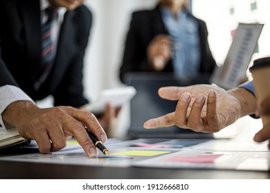 The atmosphere in the meeting room where businessmen and business partners are meeting together, meeting summaries and brainstorming to make the company grow more. Concept of business administration.
