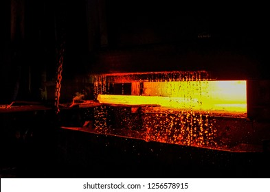 Atmosphere of steel-making furnace in smelting steel plant. High temperature in the melting furnace. Metallurgical industry. Roll of hot metal.
