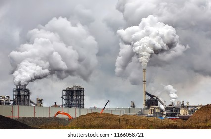 Atmospheric Air Pollution From Industrial Smoke Now. Pipes Steel Plant. Thick Smoke and Steam of MDF Production. Works in Cloudy Rainy Day. Environmental pollution.