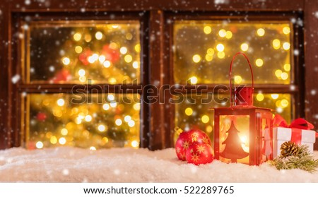 atmospheric christmas window sill with decoration and blur tree with lights inside